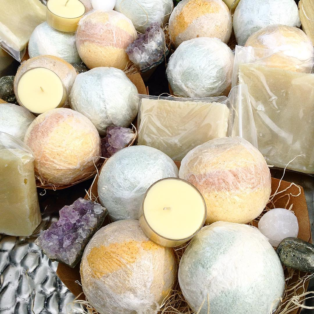 All natural Crystal spa bath sets including for giant bath melts / patchouli, peppermint tea tree, ginger lime and citrus cedar sage paired with a palo santo smudge, amethyst specimen, selenite sphere, polished pyrite, 3 oz Vegan Lime soap and a Beach Guardian scented Crystal Tealight