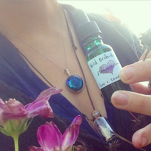 Headed to my marketing job this am - woke up with intense anxiety. Had to take a breather and also a minute with these wonderful flower essences and Hawaiian orchid necklace from @honestowlherbal . Wow - the energy I received from her package took me back. I'm so grateful for this rescue this am - goodbye anxiety - hello world! Also I have this eclipse piece on by @emmyeffdesigns grateful for the flowers still blooming. Never stop blooming! Have a good Friday my friends!